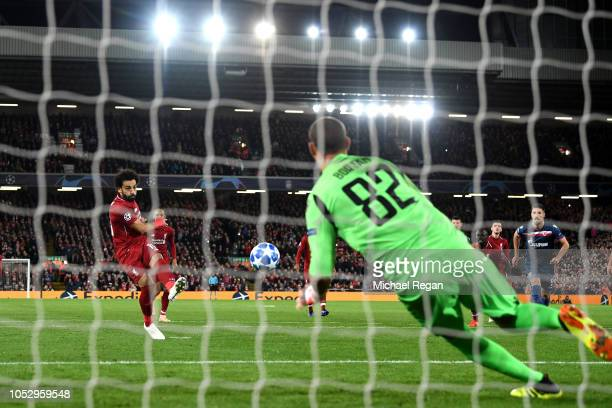 Mohamed Salah of Liverpool scores his team's third goal from the penalty spot past Milan Borjan of FK Crvena Zvezda during the Group C match of the...
