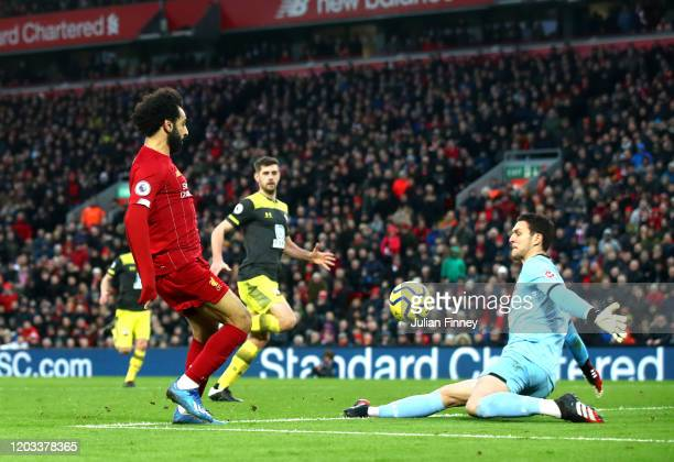 Mohamed Salah of Liverpool scores his team's third goal past Alex McCarthy of Southampton during the Premier League match between Liverpool FC and...