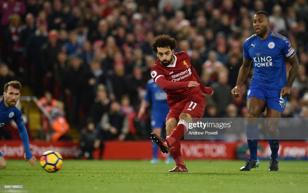 Mohamed Salah of Liverpool scores the equalising goal during the Premier League match between Liverpool and Leicester City at Anfield on December 30, 2017 in Liverpool, England.