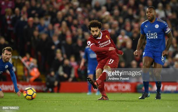 Mohamed Salah of Liverpool scores the equalising goal during the Premier League match between Liverpool and Leicester City at Anfield on December 30...