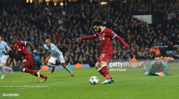 Mohamed Salah of Liverpool Scores the First during the UEFA Champions League Quarter Final Second Leg match between Manchester City and Liverpool at...