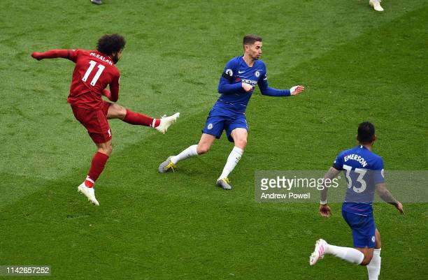 Mohamed Salah of Liverpool scores the first goal during the Premier League match between Liverpool FC and Chelsea FC at Anfield on April 14 2019 in...