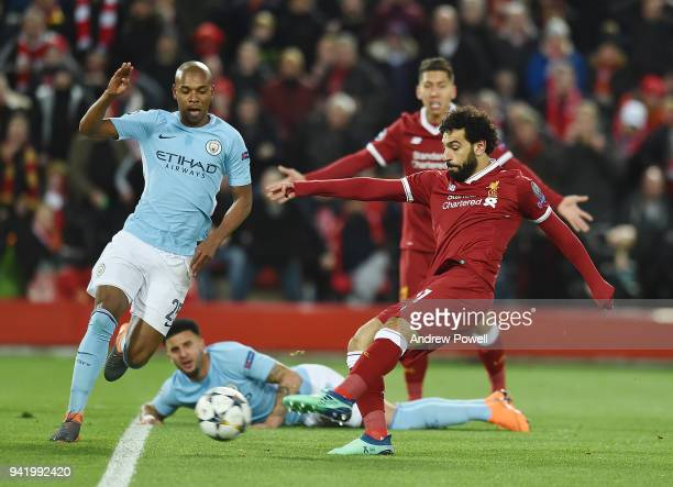 Mohamed Salah of Liverpool scores the first goal during the UEFA Champions League Quarter Final Leg One match between Liverpool and Manchester City...