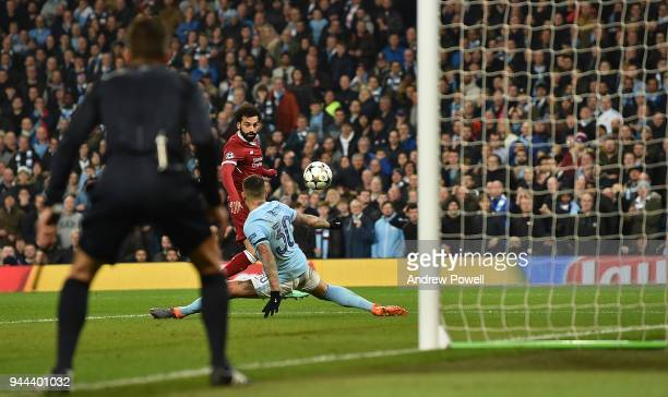 Mohamed Salah of Liverpool Scores the first Goal during the UEFA Champions League Quarter Final Second Leg match between Manchester City and...