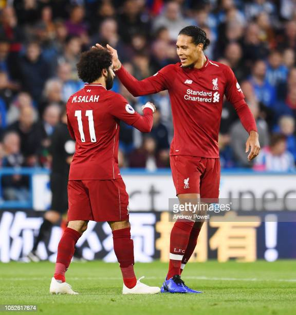 Mohamed Salah of Liverpool scores the opener and celebrates during the Premier League match between Huddersfield Town and Liverpool FC at John...