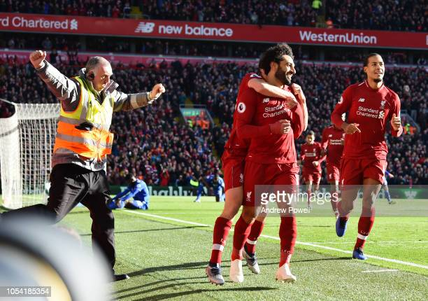 Mohamed Salah of Liverpool scores the opener and celebrates during the Premier League match between Liverpool FC and Cardiff City at Anfield on...
