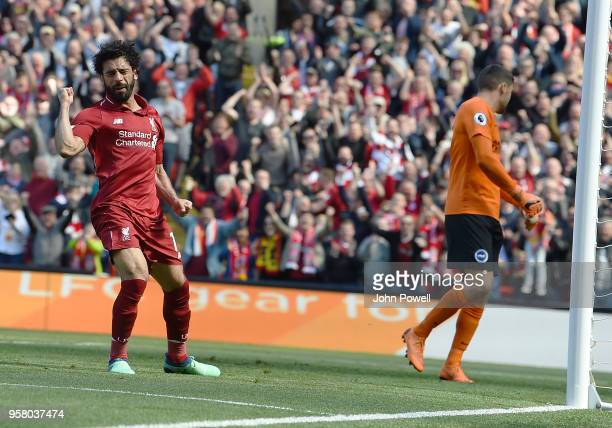 Mohamed Salah of Liverpool scores the opener and Celebrates during the Premier League match between Liverpool and Brighton and Hove Albion at Anfield...