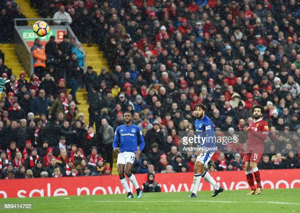 Mohamed Salah of Liverpool Scores the opener during the Premier League match between Liverpool and Everton at Anfield on December 10 2017 in...