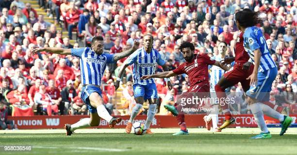 Mohamed Salah of Liverpool scores the opener for Liverpool during the Premier League match between Liverpool and Brighton and Hove Albion at Anfield...