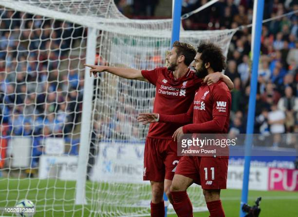 Mohamed Salah of Liverpool scores the opening goal and celebrates during the Premier League match between Huddersfield Town and Liverpool FC at John...