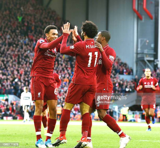 Mohamed Salah of Liverpool scores the opening goal and celebrates during the Premier League match between Liverpool FC and Fulham FC at Anfield on...
