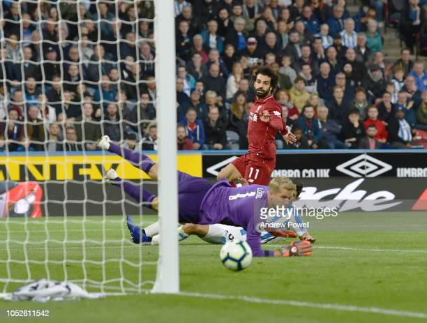 Mohamed Salah of Liverpool scores the opening goal during the Premier League match between Huddersfield Town and Liverpool FC at John Smith's Stadium...
