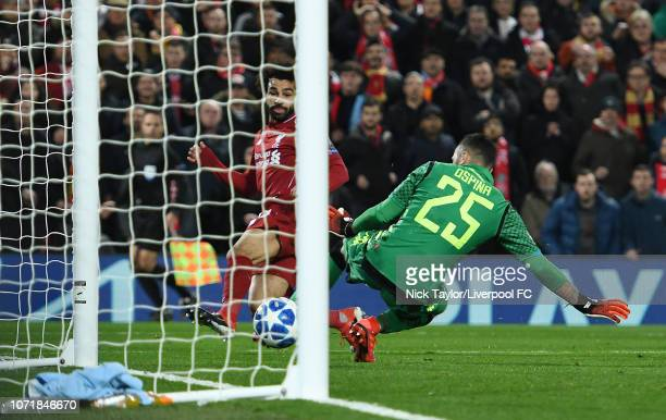 Mohamed Salah of Liverpool scores the opening goal during the UEFA Champions League Group C match between Liverpool and SSC Napoli at Anfield on...