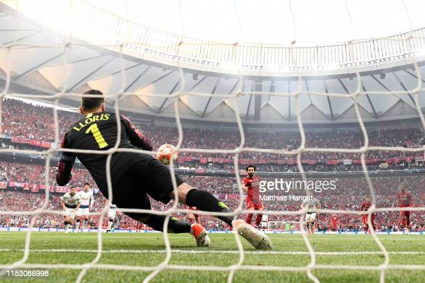 Mohamed Salah of Liverpool scores the opening goal past Hugo Lloris of Tottenham Hotspur from the penalty spot during the UEFA Champions League Final...
