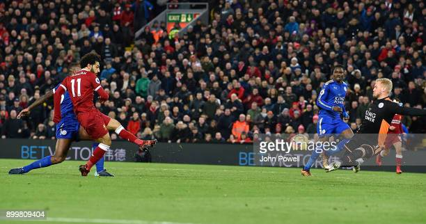 Mohamed Salah of Liverpool Scores the second during the Premier League match between Liverpool and Leicester City at Anfield on December 30 2017 in...