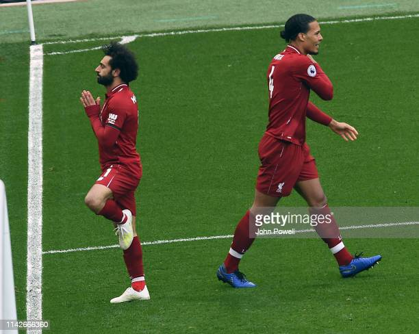 Mohamed Salah of Liverpool scores the second goal during the Premier League match between Liverpool FC and Chelsea FC at Anfield on April 14 2019 in...