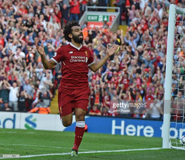 Mohamed Salah of Liverpool scores the third and celebrates during the Premier League match between Liverpool and Arsenal at Anfield on August 27 2017...