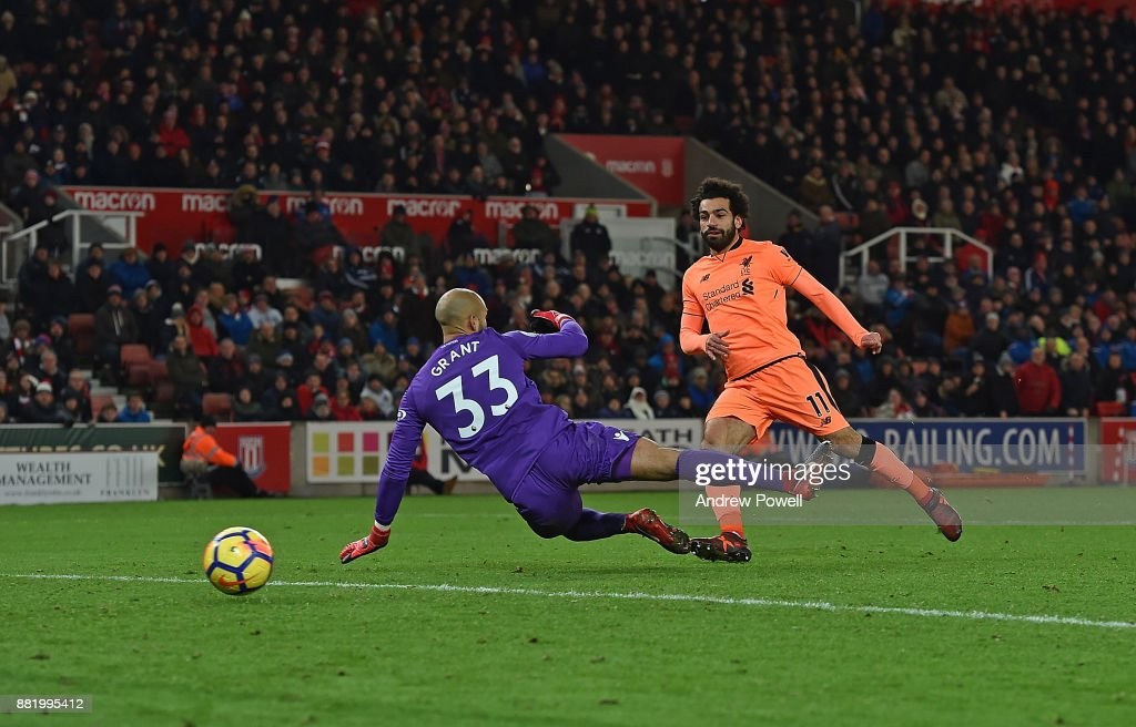 Mohamed Salah of Liverpool scores the third during the Premier League match between Stoke City and Liverpool at Bet365 Stadium on November 29, 2017 in Stoke on Trent, England.
