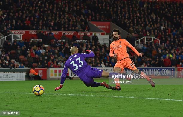 Mohamed Salah of Liverpool scores the third during the Premier League match between Stoke City and Liverpool at Bet365 Stadium on November 29 2017 in...
