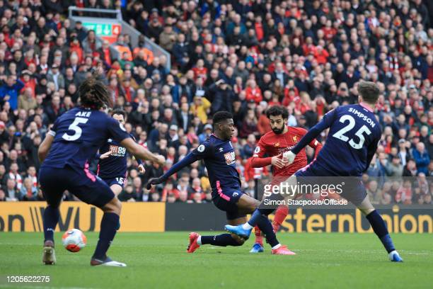 Mohamed Salah of Liverpool scores their 1st goal during the Premier League match between Liverpool FC and AFC Bournemouth at Anfield on March 7 2020...
