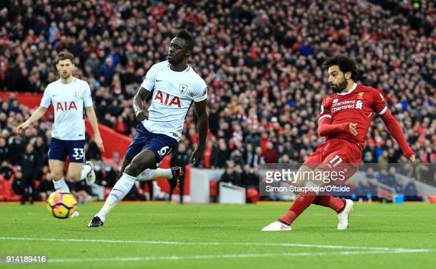 Mohamed Salah of Liverpool scores their 1st goal during the Premier League match between Liverpool and Tottenham Hotspur at Anfield on February 4...