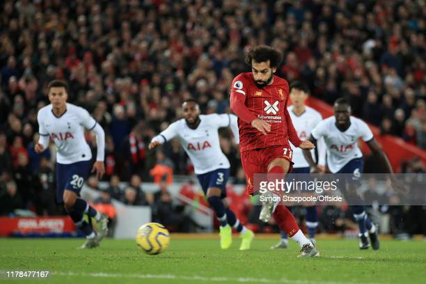 Mohamed Salah of Liverpool scores their 2nd goal with a penalty during the Premier League match between Liverpool FC and Tottenham Hotspur at Anfield...
