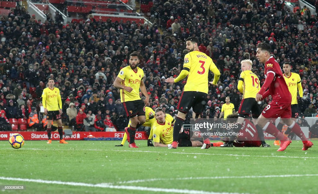Mohamed Salah of Liverpool scores their 4th goal during the Premier League match between Liverpool and Watford at Anfield on March 17, 2018 in Liverpool, England.