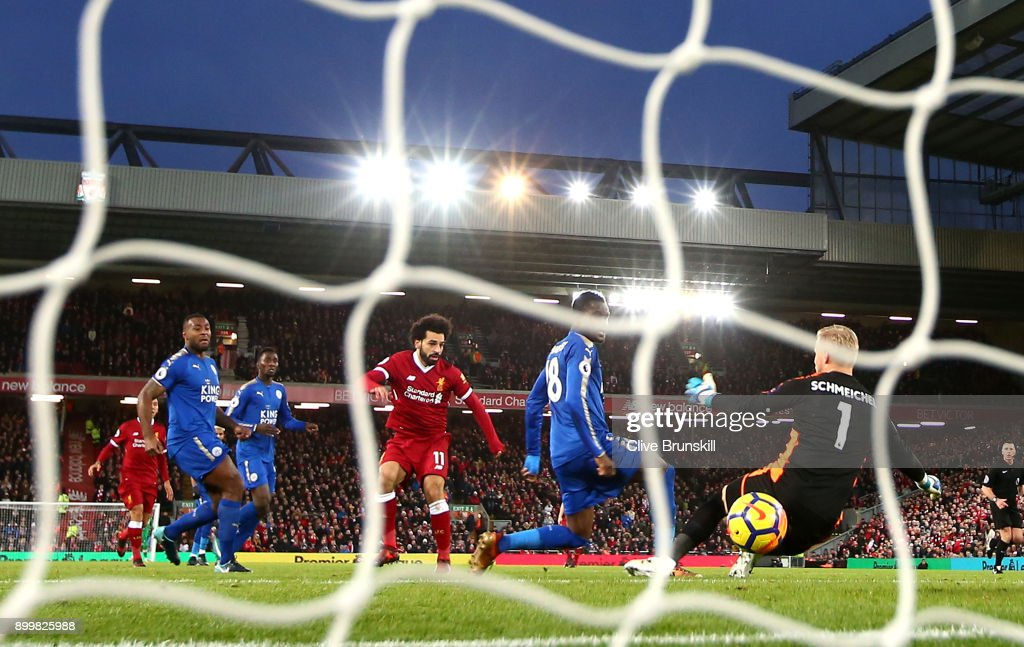 Mohamed Salah of Liverpool scores their first goal past Kasper Schmeichel of Leicester City during the Premier League match between Liverpool and Leicester City at Anfield on December 30, 2017 in Liverpool, England.