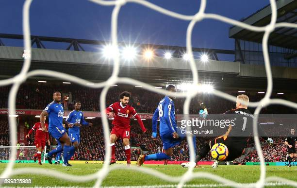 Mohamed Salah of Liverpool scores their first goal past Kasper Schmeichel of Leicester City during the Premier League match between Liverpool and...