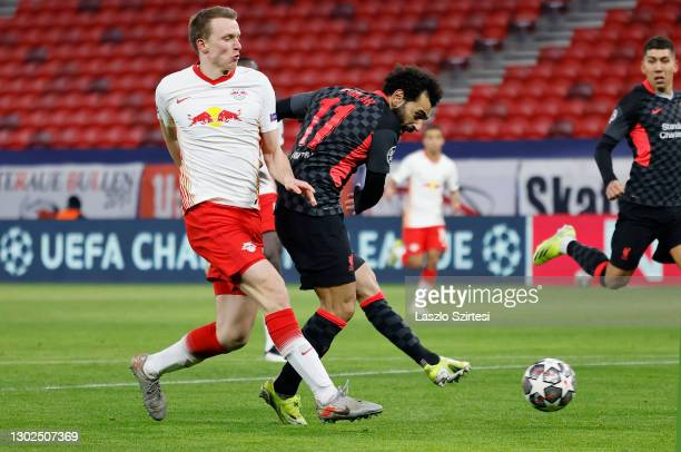 Mohamed Salah of Liverpool scores their side's first goal as he competes with Lukas Klostermann of RB Leipzig during the UEFA Champions League Round...