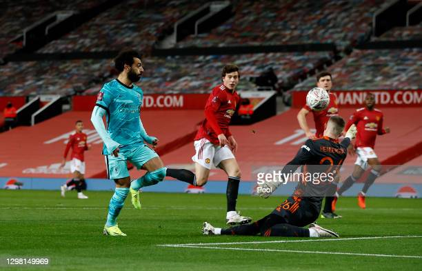 Mohamed Salah of Liverpool scores their side's first goal past Dean Henderson of Manchester United during The Emirates FA Cup Fourth Round match...