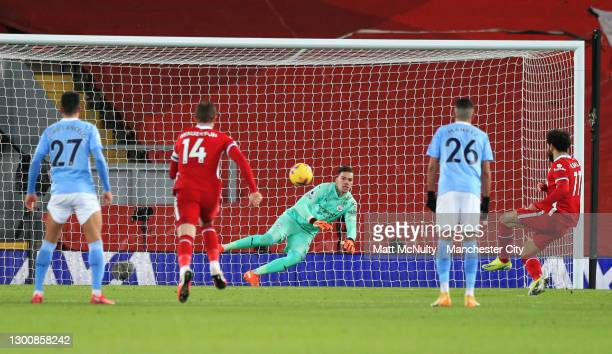 Mohamed Salah of Liverpool scores their side's first goal past Ederson of Manchester City from the penalty spot during the Premier League match...