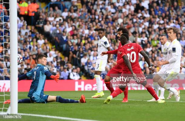 Mohamed Salah of Liverpool scores their side's first goal past Illan Meslier of Leeds United during the Premier League match between Leeds United and...
