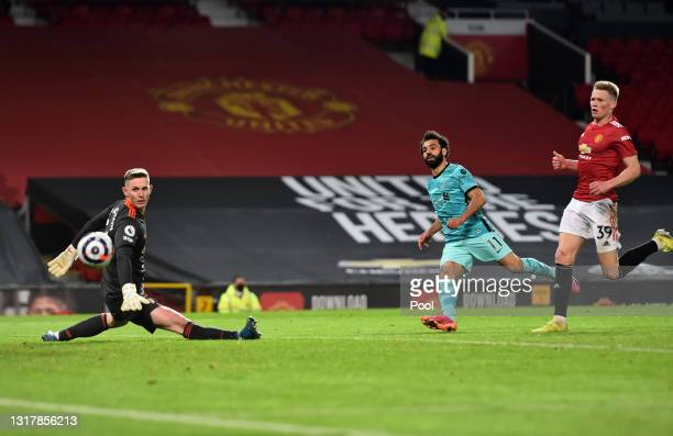 Mohamed Salah of Liverpool scores their side's fourth goal past Dean Henderson of Manchester United during the Premier League match between...