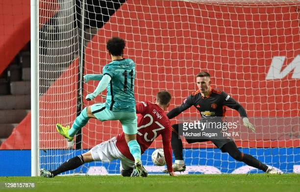 Mohamed Salah of Liverpool scores their sides second goal past Dean Henderson of Manchester United during The Emirates FA Cup Fourth Round match...