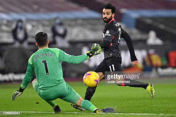 Mohamed Salah of Liverpool scores their side's second goal past Lukasz Fabianski of West Ham United during the Premier League match between West Ham...
