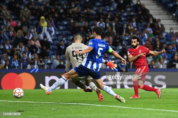 Mohamed Salah of Liverpool scores their side's third goal past Diego Costa of FC Porto during the UEFA Champions League group B match between FC...