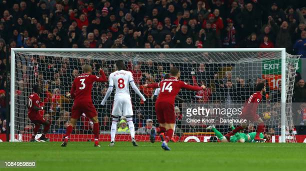 Mohamed Salah of Liverpool scores their teams first goal during the Premier League match between Liverpool FC and Crystal Palace FC at Anfield on...
