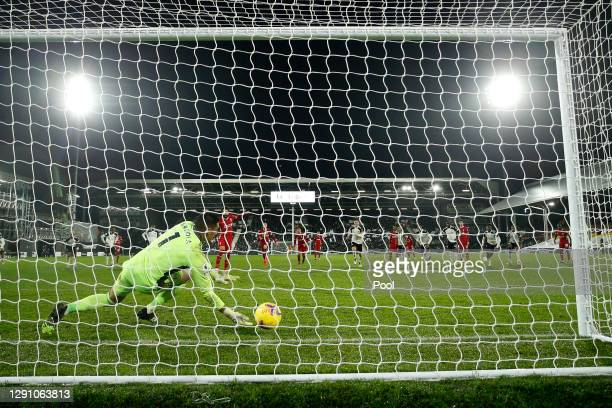 Mohamed Salah of Liverpool scores their team's first goal from the penalty spot past Alphonse Areola of Fulham during the Premier League match...