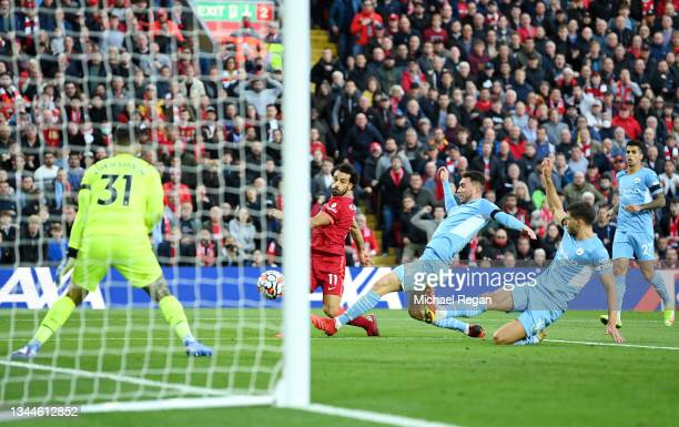 Mohamed Salah of Liverpool scores their team's second goal during the Premier League match between Liverpool and Manchester City at Anfield on...