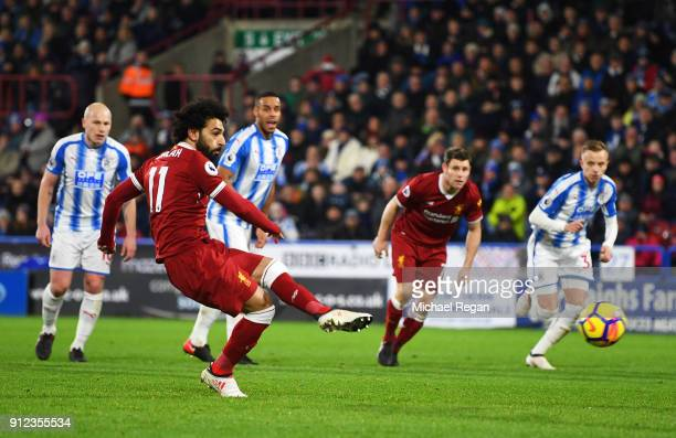 Mohamed Salah of Liverpool scores their third goal from the penalty spot during the Premier League match between Huddersfield Town and Liverpool at...