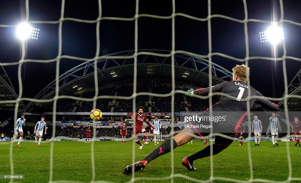 Mohamed Salah of Liverpool scores their third goal from the penalty spot past Jonas Lossl of Huddersfield Town during the Premier League match between Huddersfield Town and Liverpool at John Smith's Stadium on January 30, 2018 in Huddersfield, England.
