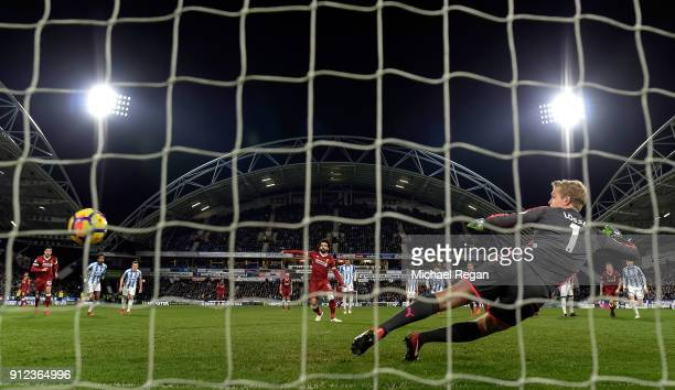 Mohamed Salah of Liverpool scores their third goal from the penalty spot past Jonas Lossl of Huddersfield Town during the Premier League match...