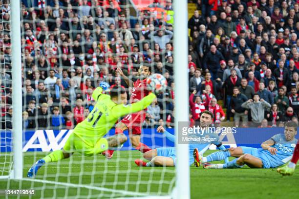 Mohamed Salah of Liverpool scores to make it 2-1 during the Premier League match between Liverpool and Manchester City at Anfield on October 03, 2021...