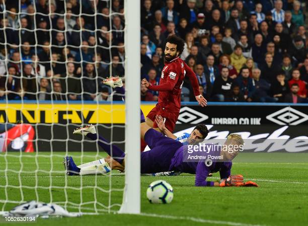 Mohamed Salah of Liverpool scoring the opening goal during the Premier League match between Huddersfield Town and Liverpool FC at John Smith's...