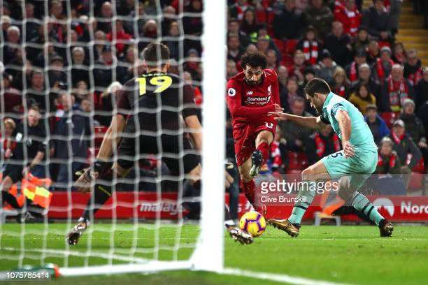 Mohamed Salah of Liverpool sees his shot saved by Bernd Leno of Arsenal during the Premier League match between Liverpool FC and Arsenal FC at...
