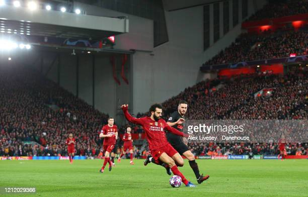 Mohamed Salah of Liverpool shields the ball from Koke of Atletico Madrid during the UEFA Champions League round of 16 second leg match between...