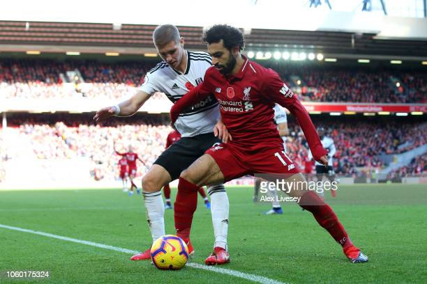 Mohamed Salah of Liverpool shields the ball from Maxime Le Marchand of Fulham during the Premier League match between Liverpool FC and Fulham FC at...