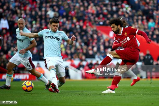 Mohamed Salah of Liverpool shoots and scores his side's second goal during the Premier League match between Liverpool and West Ham United at Anfield...