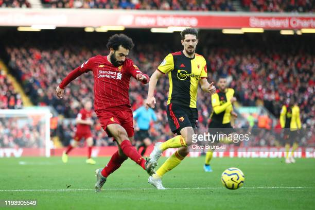 Mohamed Salah of Liverpool shoots during the Premier League match between Liverpool FC and Watford FC at Anfield on December 14 2019 in Liverpool...